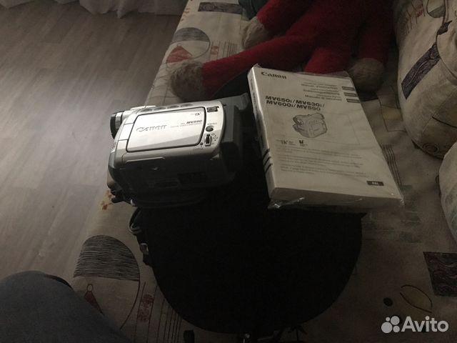 находится инструкция видеокамеры канон мв 590 Подборок окне, левый