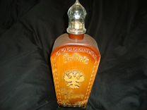 Бутылка в деревянном обромлении
